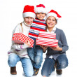 Stock Photo: Happy kids in Santa's hat with gift box