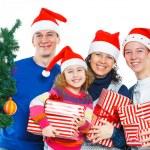 Family in Santa's hat — Stock Photo