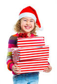 Little girl in Santa's hat with gift box — Photo