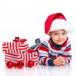 Little boy in Santa's hat with gift box — Stock Photo #16333657
