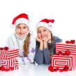 Happy girls in Santa's hat with gift box — Stockfoto