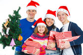 Family in Santa's hat — Stock Photo
