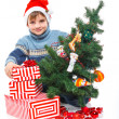 Little boy in Santa&#039;s hat with gift box - Stock Photo