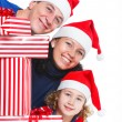 Family with Christmas presents - Stock Photo