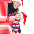Family with Christmas presents — Stock Photo