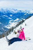 Young skier sitting on the hill — Stock Photo