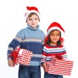 Little kids in Santa's hat with gift box — Stock Photo #16928765