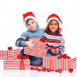 Little kids in Santa's hat with gift box — Stock Photo #16928811