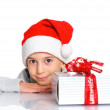 Little boy in Santa's hat with gift box — Stock Photo #16929389