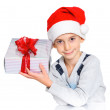 Little boy in Santa's hat with gift box — Stock Photo #16929421