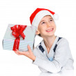 Little boy in Santa's hat with gift box — Stock Photo #16929433