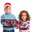 Royalty-Free Stock Photo: Kids in Santa\'s hat holding a christmas ball