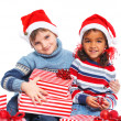 Little kids in Santa's hat with gift box — Stok fotoğraf