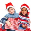 Little kids in Santa's hat with gift box — Photo