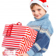 Little boy in Santa's hat with gift box — Stock Photo #16940459