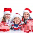 Royalty-Free Stock Photo: Happy kids in Santa\'s hat with gift box