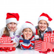 Happy kids in Santa's hat with gift box — Stock Photo #16940501
