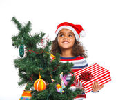 Little girl in Santa's hat with gift box — Stock fotografie