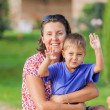 Portrait of little boy with his mother — Stock Photo