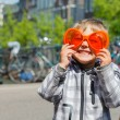 Boy walking in orange outfit for Dutch Queensday - Stock Photo
