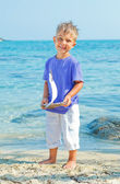 Boy with toy ship — Stock Photo