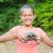 图库照片: Young girl and turtle