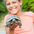 Young girl and turtle — Stock Photo