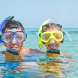 The girl with her father in scuba mask - Stock Photo