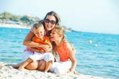 Photo of happy family on the beach — Stock Photo