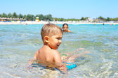 Portrait of young boy swimming in the transparent sea — Стоковое фото