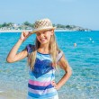 Cute girl in hat on the beach — Stock Photo #19295581