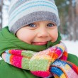 Portrait of a little baby boy in winter forest. — Stock Photo
