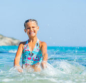 Girl swimming in sea — Stock Photo