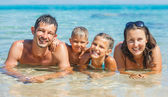 Happy family in the sea — Stock Photo