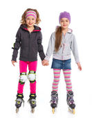 Two cute girls in roller skates — Stockfoto