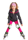 Cute girl in roller skates — ストック写真