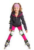 Roztomilá dívka v kolečkové brusle — Stock fotografie