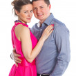 Portrait of a beautiful young happy smiling couple. Isolated white backround — Stock Photo