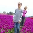 Stock Photo: Girl with grandmother in purple tulips field