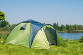Green camping tent — Stock Photo