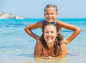 Girl with mother swimming in sea — Stock Photo