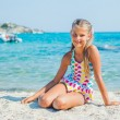 Cute girl on the beach - Stock fotografie