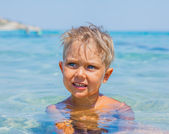 Young boy swimming in sea — Stock Photo