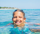 Young girl in the sea — Stock Photo