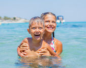 Kids playing in the sea — Stock Photo