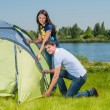 Couple Setting Up Tent — 图库照片
