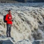 Man standing near Dettifoss waterfall — Stock Photo #21616921