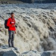 Mstanding near Dettifoss waterfall — Stock Photo #21616921