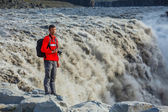 Man standing near Dettifoss waterfall — Stock Photo