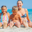Summer beach - family playing on sandy beach. Focus on the feet and boy. — Stock Photo